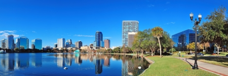 Orlando Lake Eola in the morning with urban skyscrapers and clear blue sky  photo