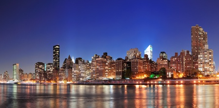 New York City Manhattan midtown skyline at night over East River  photo