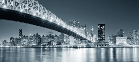 Queensboro Bridge over New York City East River black and white at night with river reflections and midtown Manhattan skyline illuminated.  Stock Photo - 14361064