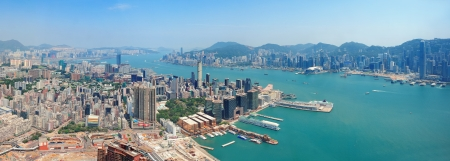 Hong Kong aerial view panorama with urban skyscrapers boat and sea   photo