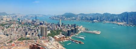 kong: Hong Kong aerial view panorama with urban skyscrapers boat and sea