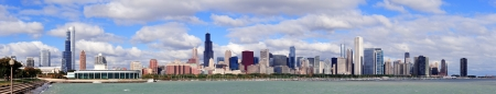 chicago skyline: Chicago skyline panorama with skyscrapers over Lake Michigan with cloudy blue sky