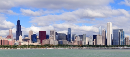 lake michigan: Chicago skyline panorama with skyscrapers over Lake Michigan with cloudy blue sky