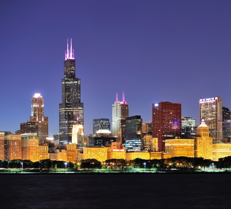 lakefront: Chicago city downtown urban skyline at dusk with skyscrapers over Lake Michigan with clear blue sky  Stock Photo