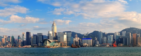 hong kong harbour: Hong Kong Victoria Harbor in afternoon with urban city skyline and colorful cloud Stock Photo
