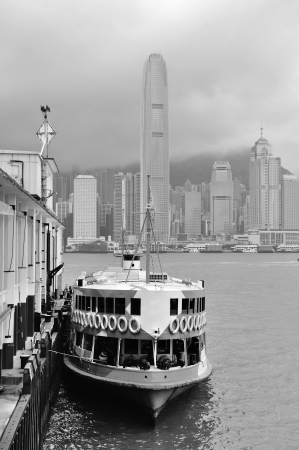 Hong Kong skyline with boats in Victoria Harbor in black and white. Stock Photo - 14449681