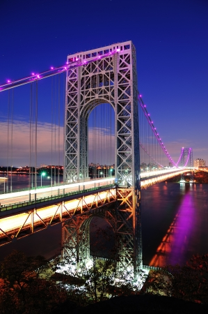 steel arch bridge: George Washington Bridge at dusk over Hudson River. Stock Photo