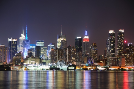 empire state: New York City Manhattan midtown skyline at night with lights reflection over Hudson River viewed from New Jersey Weehawken waterfront. Stock Photo