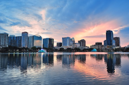 orlando: Orlando Lake Eola sunset with urban architecture skyline and colorful cloud Stock Photo