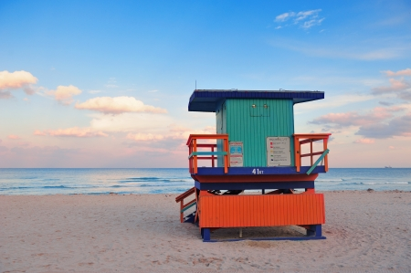 lifeguard tower: Miami South Beach sunset with lifeguard tower and coastline with colorful cloud and blue sky.
