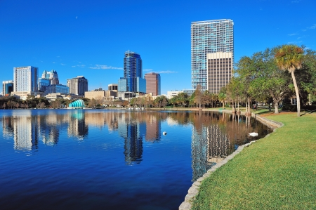 orlando: Orlando Lake Eola in the morning with urban skyscrapers and clear blue sky.