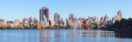 New York City Manhattan Central Park midtown skyline panorama over lake with fountain and blue clear sky in Autumn  photo