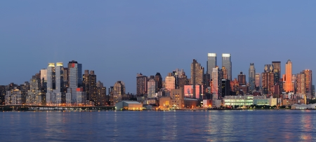 weehawken: Hudson River waterfront view of New York City Manhattan after sunset with cityscape panorama and light reflection in tranquil blue tone  Stock Photo