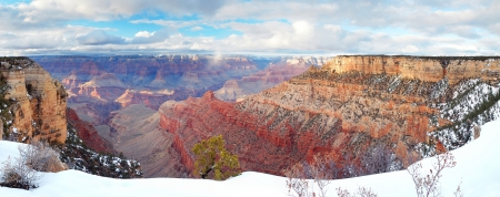 Grand Canyon panorama view in winter with snow and clear blue sky  photo