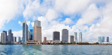 Miami skyline panorama in the day with urban skyscrapers and cloudy sky over sea  Imagens