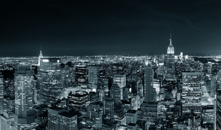 New York City Manhattan skyline at night panorama black and white with urban skyscrapers