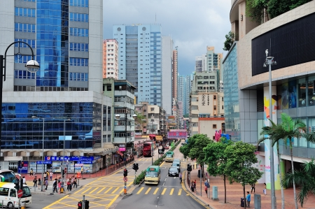 sq: HONG KONG, CHINA - APR 23: Street view with traffic on April 23, 2012 in Hong Kong, China. With 7M population and land mass of 1104 sq km, it is one of the most dense areas in the world. Editorial