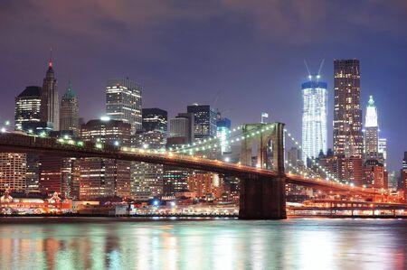 brooklyn: New York City Brooklyn Bridge with downtown skyline over East River.