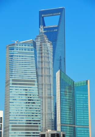 pudong district: Shanghai urban skyline with blue clear sky over Huangpu River.