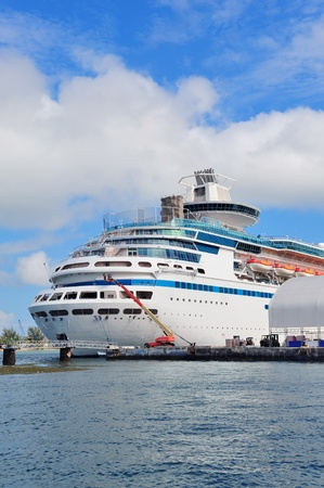 Cruise ship park at Miami dock with cloud and blue sky.