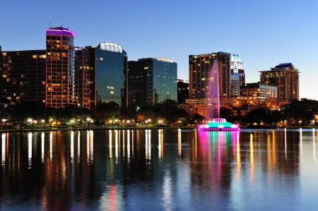 Orlando downtown skyline panorama over Lake Eola at dusk with urban skyscrapers and clear sky  Editorial