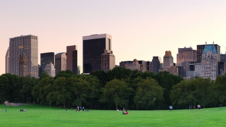 New York City Central Park at dusk panorama with Manhattan skyline and skyscrapers