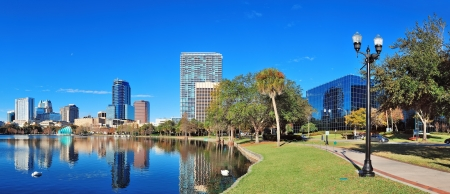 Orlando Lake Eola in the morning with urban skyscrapers and clear blue sky