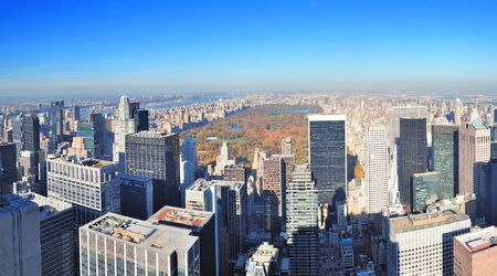 central park: New York City skyscrapers in midtown Manhattan aerial panorama view in the day with Central Park and colorful foliage in Autumn