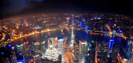 pudong district: Shanghai night aerial view with urban architecture and river Editorial
