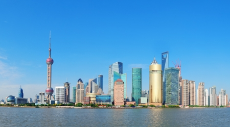 shanghai pudong skyline: Shanghai skyline panorama with skyscrapers and blue clear sky over Huangpu River  Editorial