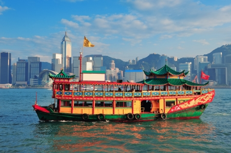 hong kong people: Hong Kong skyline with boats in Victoria Harbor.