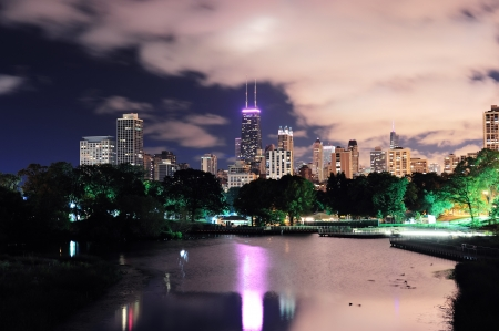 Chicago city urban skyscraper at night over lake viewed from Lincoln Park. photo