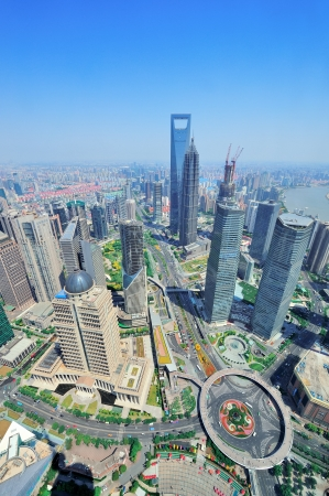 pudong district: Shanghai city aerial view with urban architecture and blue sky in the day.