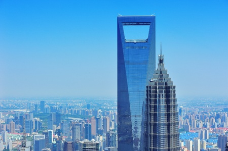 shanghai skyline: Shanghai city aerial view with urban architecture and blue sky in the day.