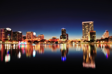 Orlando downtown skyline panorama over Lake Eola at night with urban skyscrapers and clear sky  Stock Photo