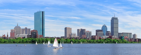 boston cityscape: Boston Charles River panorama with urban city skyline skyscrapers and boats with blue sky  Stock Photo