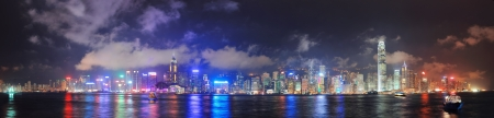 hong kong night: Hong Kong skyline panorama at night with clouds over Victoria Harbour