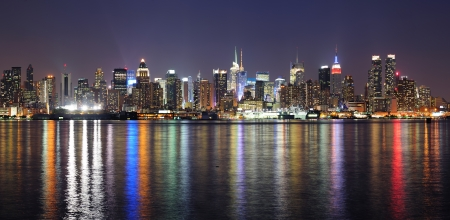 New York City Manhattan midtown skyline at night with lights reflection over Hudson River viewed from New Jersey Weehawken waterfront  Stock Photo