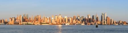 New York City Manhattan midtown skyline panorama at sunset
