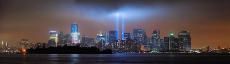 New York City Manhattan downtown skyline at night from Liberty Park with light beams in memory of September 11 viewed from New Jersey waterfront  photo