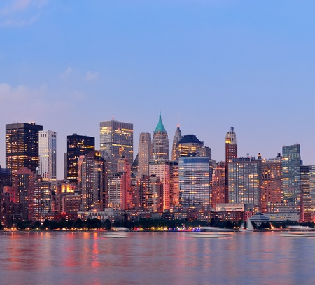 New York City Manhattan downtown skyline at sunset over Hudson River panorama photo