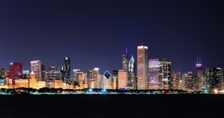 Chicago city downtown urban skyline panorama at dusk with skyscrapers over Lake Michigan with clear blue sky  photo