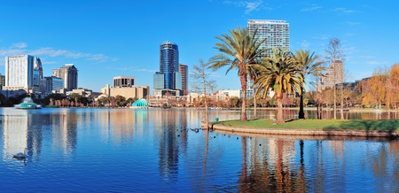 lake district: Orlando Lake Eola in the morning with urban skyscrapers and clear blue sky.