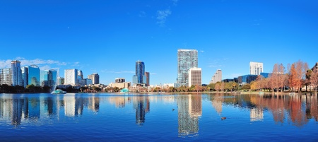 Orlando Lake Eola in the morning with urban skyscrapers and clear blue sky. photo