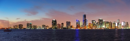 Miami city skyline panorama at dusk with urban skyscrapers over sea with reflection Stock Photo - 14803929
