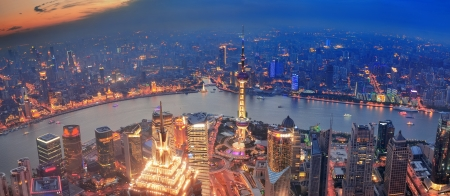pudong district: Shanghai sunset aerial view with urban architecture and river