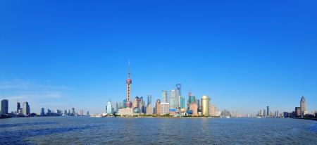 huangpu: Shanghai skyline panorama with skyscrapers and blue clear sky over Huangpu River. Stock Photo