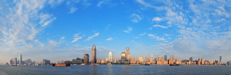 Shanghai historic and urban buildings over Huangpu River in the morning with blue sky. photo