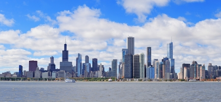 Chicago city urban skyline panorama with skyscrapers over Lake Michigan with cloudy blue sky. photo