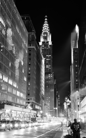 42nd: NEW YORK CITY, NY, USA - DEC 30: Chrysler Building at night with street on December 30, 2011, New York City. It was designed by architect William Van Alena as Art Deco architecture in US.